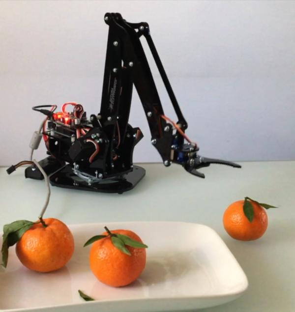 Posizionamento braccio robot arance